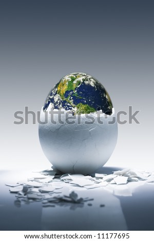 Creative conceptual image.Planet Earth birth from egg. Earth in this montage provided by NASA (http://visibleearth.nasa.gov/) - stock photo
