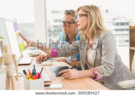 Creative design team working together on computer in the office - stock photo