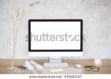 Creative desktop with blank white computer monitor, wheat spikes, glasses, smart phone, sketches and coffee cup on concrete background. Mock up - stock photo