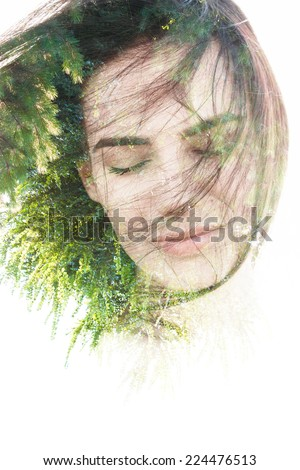 Creative double exposure portrait of woman combined with photograph of nature - stock photo
