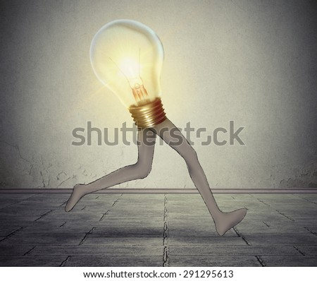 Creative energy quick thinking business concept glowing bright light bulb with long legs running fast creativity performance metaphor for fast production idea solution - stock photo