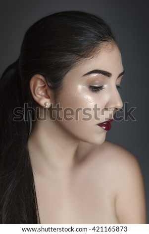 Creative fashion beauty makeup with face glowing effect. - stock photo