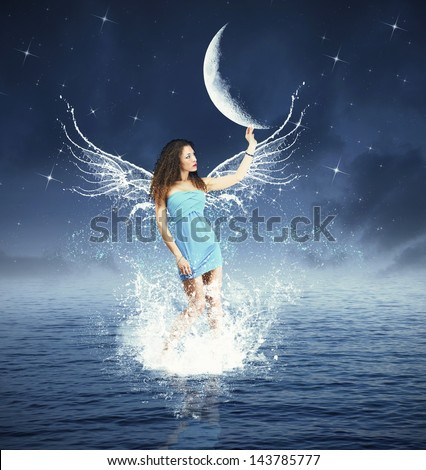 Creative fashion with fairy touching the moon - stock photo