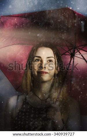 Creative fine art of a beautiful woman walking unhindered through the pouring rain with umbrella. Resilient in storms by positive thinking - stock photo