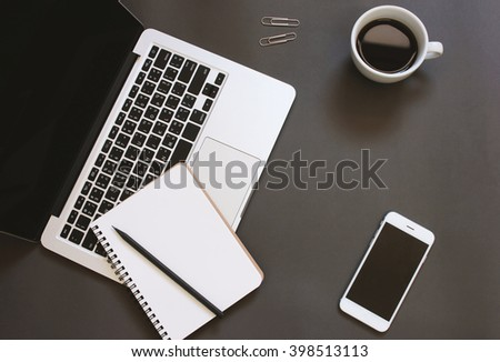 Creative flat lay design of workspace desk with laptop, notebook, smartphone and coffee with copy space background - stock photo