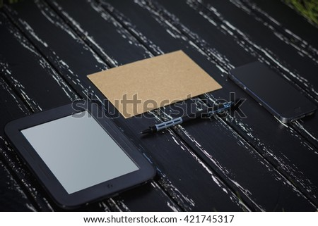 Creative flat lay photo of workspace desk with smartphone, tag, letter and notebook with copy space background, minimal style, Can be used as a background, blank for design, logo design. - stock photo