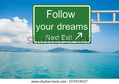 Creative Follow your dreams Road Sign  - stock photo