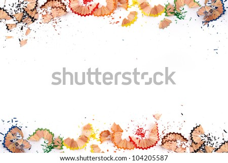 Creative frame made of color pencil shavings a on a white paper - stock photo