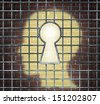 Creative freedom key with a human head light glowing on a brick wall through a prison cage opened with a keyhole shape as a business and mental health concept searching for innovative solutions. - stock photo