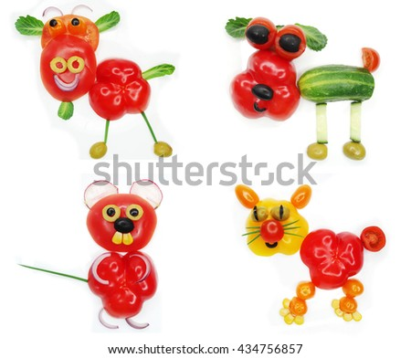 creative funny vegetable food snack with tomato cow form - stock photo