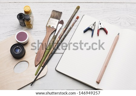 Creative group of object for painting, writing and sketching on a white hardwood table. Studio shot. - stock photo