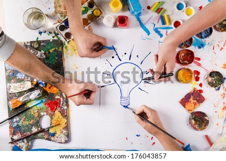 Creative idea concept with colorful paints over white paper - stock photo