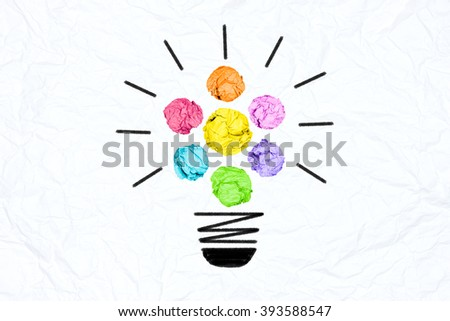 creative inspiration from brainstorm colorful concept crumpled paper light bulb metaphor for good idea from teamwork  / solution thinking answer from harmony people work - stock photo