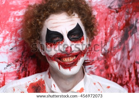 Creative make-up, conceptual crazy idea for Halloween night party. Eerie nightmare turning into zombie clown, volume spikes body art painting. Professional closeup photo. Bold skin injured, curly hair - stock photo