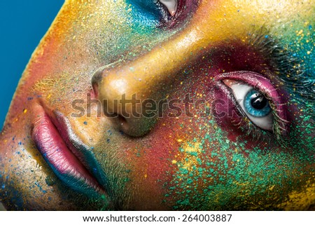 Creative make-up of colored powder closeup - stock photo