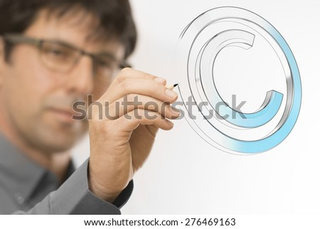 Creative man drawing copyright symbol on a transparent wall. Engineering background concept over white. - stock photo