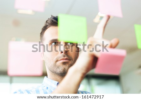 Creative man working in the office - stock photo