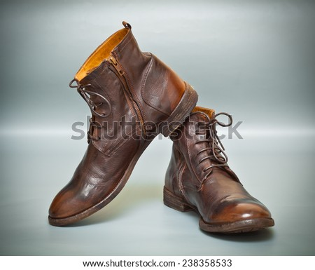 Creative men's fashion leather shoes brown color on an abstract background - stock photo