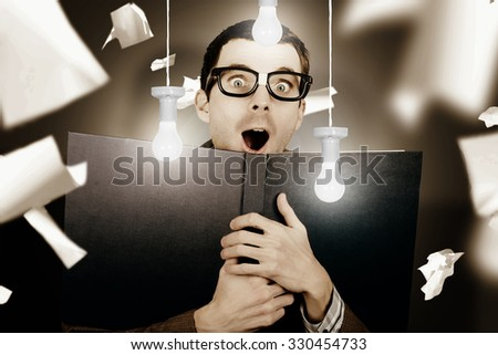 Creative photo of a surprised nerdy man reading books underneath a barrage of falling papers and hanging light bulbs. Learning bright idea - stock photo