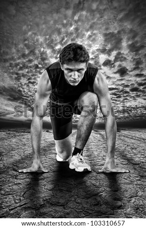 Creative photo of athletes at the start. Black and white. - stock photo