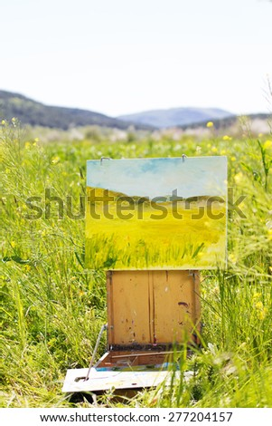 Creative picture of a yellow flower field, spring time - stock photo