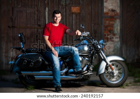 Creative portrait of a happy motorcycle rider  - stock photo