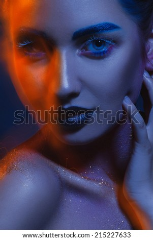 Creative portrait of cutie adult woman with mixed lights in studio - stock photo