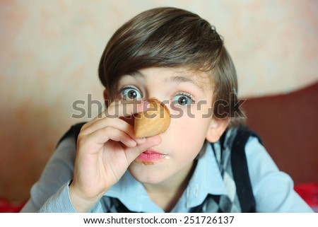 creative preteen handsome boy have an idea about pinocchio image - stock photo