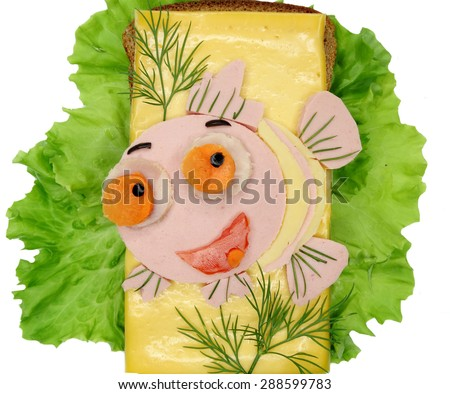 creative sandwich with cheese and salami fish form - stock photo
