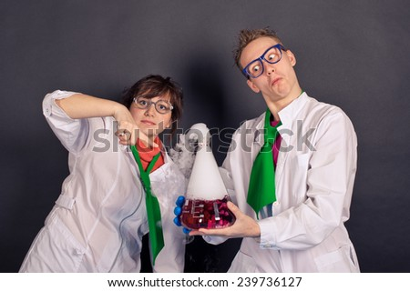 Creative scientists make experiments with liquid ice. - stock photo