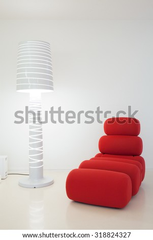 Creative settee and lamp in modern interior - stock photo