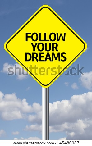 Creative sign with the message - Follow your Dreams - stock photo