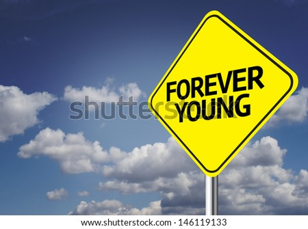 Creative sign with the message - Forever Young - stock photo