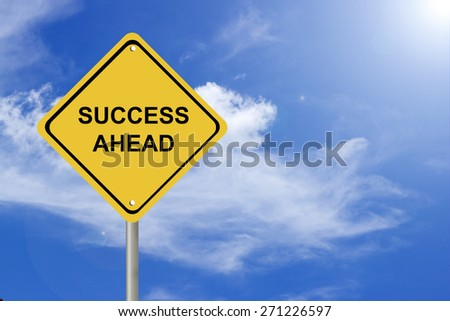 Creative sign with the message - success ahead against beautiful blue sky - stock photo