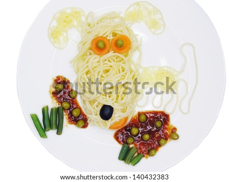 creative spaghetti food garnish with sausage dog shape - stock photo