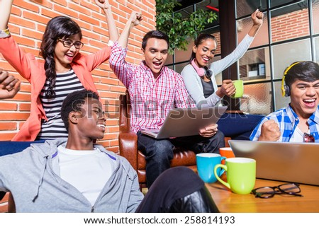 Creative students with aspirations having success being happy - stock photo