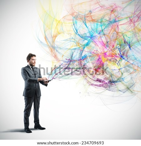 Creative technology concept with a businessman that works with a tablet - stock photo