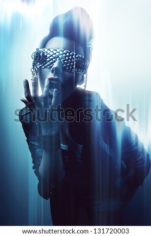creative woman in glasses in blue light - stock photo