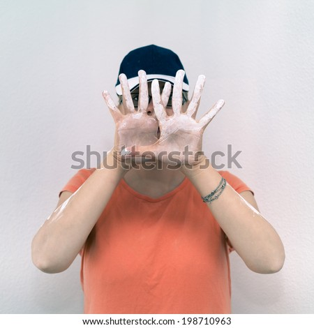 Creative woman showing her stained hands with white paint. - stock photo