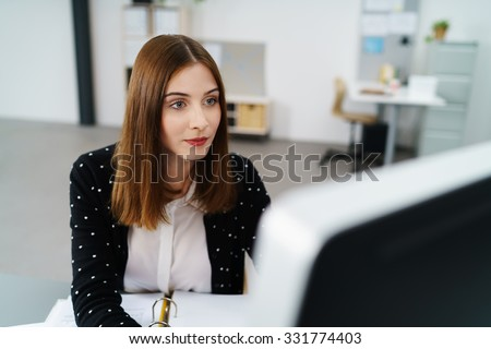 creative woman working on computer at the office - stock photo