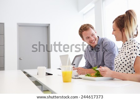 Creatives Having Working Lunch In Design Studio - stock photo
