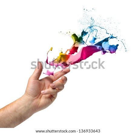 Creativity concept, hand throwing color paint splash isolated on white - stock photo