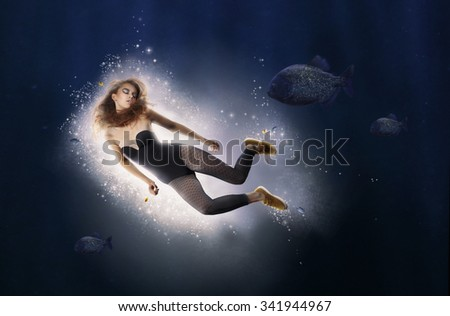 Creativity. Fantasy. Woman is Diving in Water - stock photo
