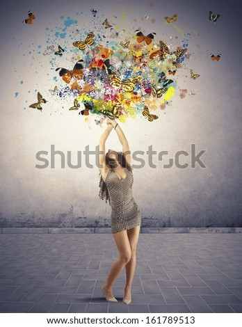 Creatoive fashion concept with explosion of butterfly and colors - stock photo