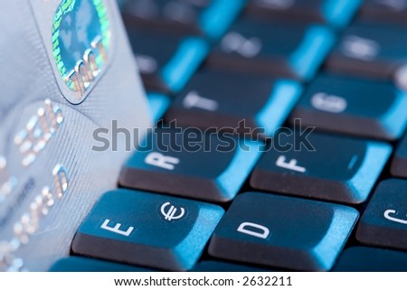 Credit Card and Keyboard. Blue light, focus on Euro-Sign. - stock photo