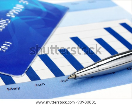 Credit card and pen on the chart - stock photo