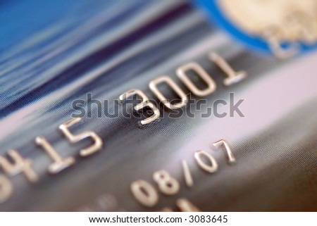 Credit card digits. Macro, shallow DOF - stock photo