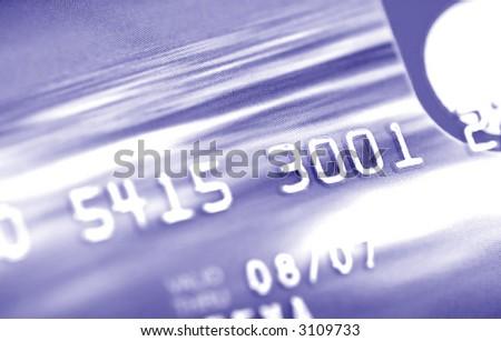 Credit card digits. Macro, shallow DOF (blue tone) - stock photo