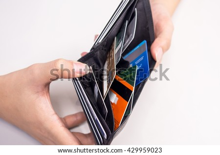 credit card in wallet - cashless - stock photo