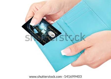 credit card in woman's hand taken out from wallet - stock photo